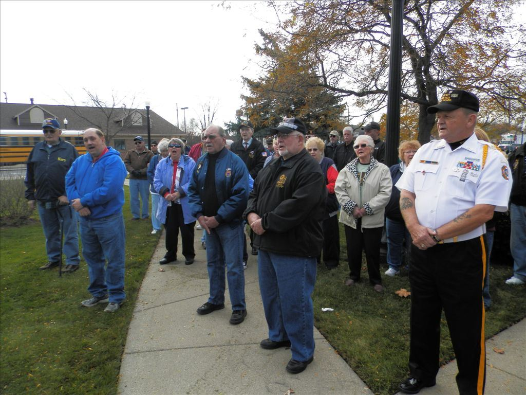 People gather and pay respect at the Veterans Day ceremony