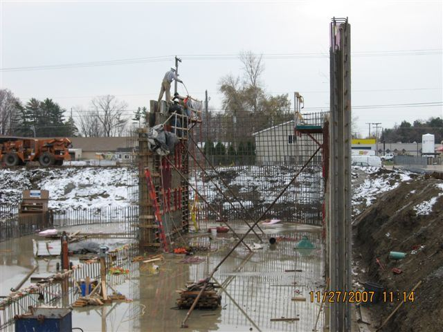Workers build the beginnings of the structure foundation